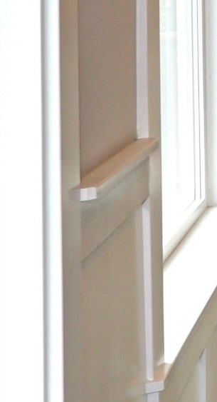 Wainscot cap molding cut at 45 degrees to transition back to window casing