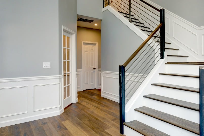Entry Foyer and stairs with wainscoting on walls.