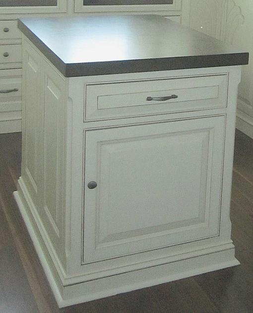 Quarter Round painted white around base of island closet cabinet