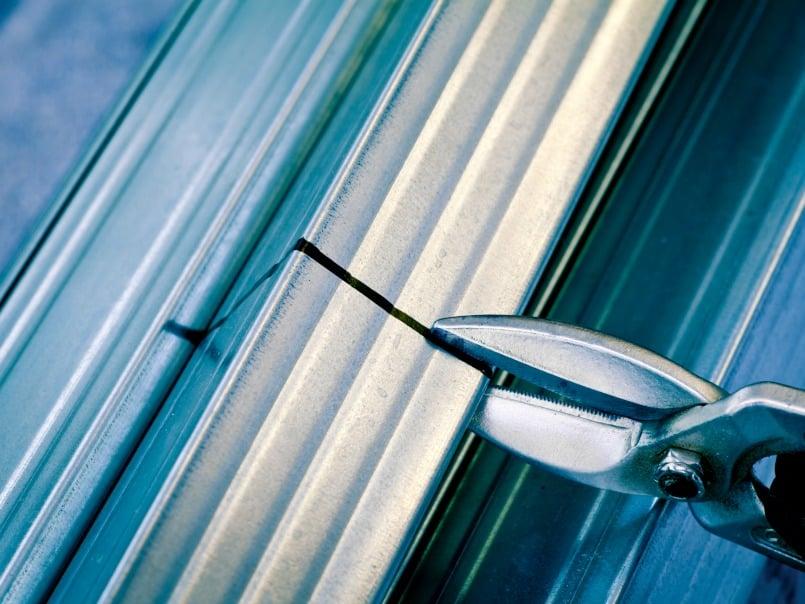 Tin snips cutting steel stud